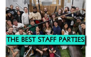 staff group up for photo with medieval arena and weapons in hand saying The best staff parties