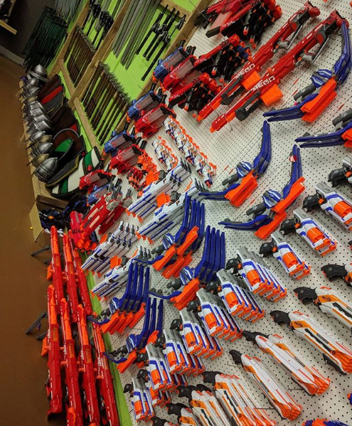nerf gun wall showing hundreds of different nerf guns