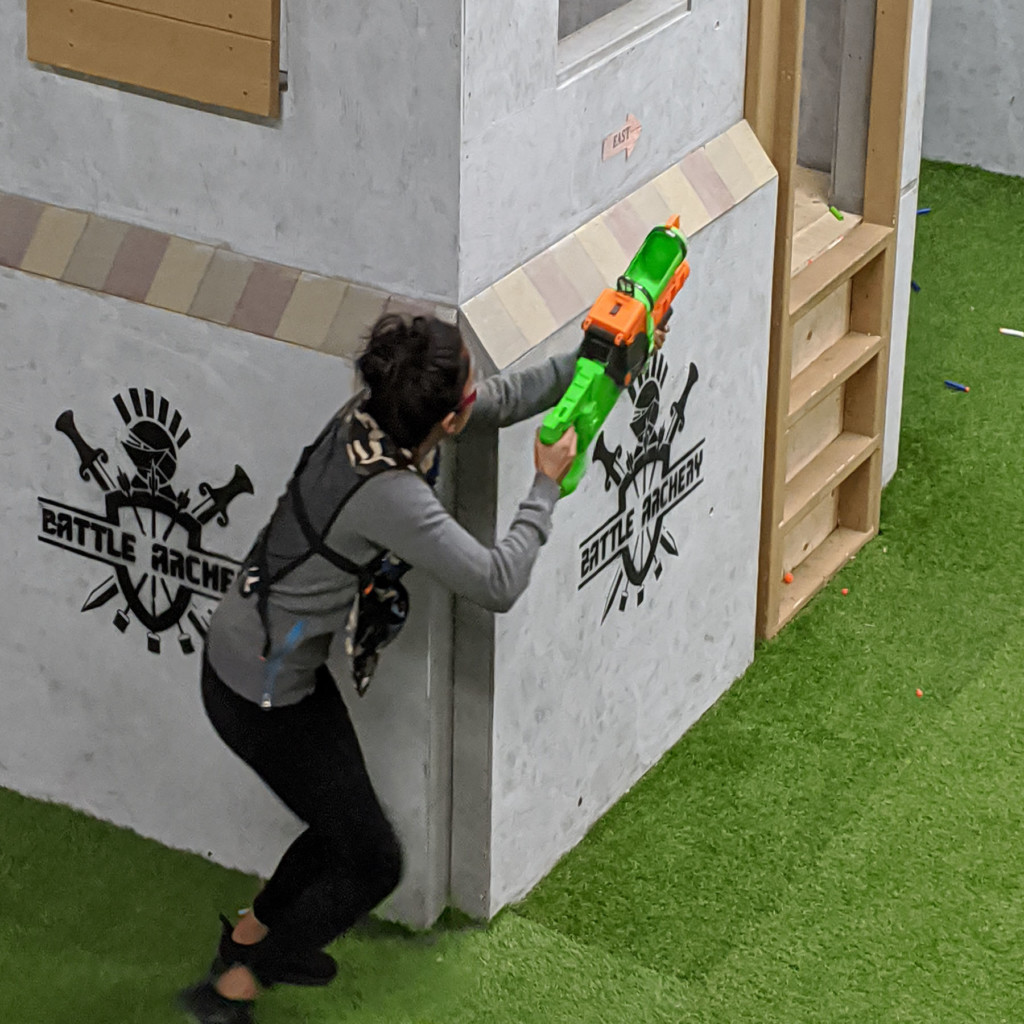nerf blaster aiming at kids in nerf arena